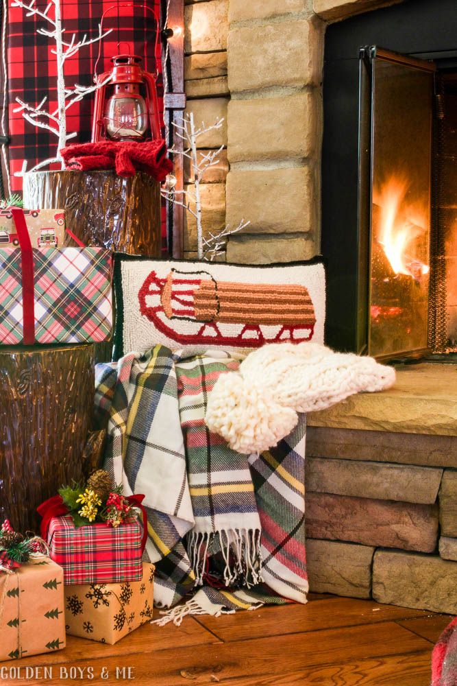 Christmas mantel decor with Birch Lane sledding pillow and plaid toboggan