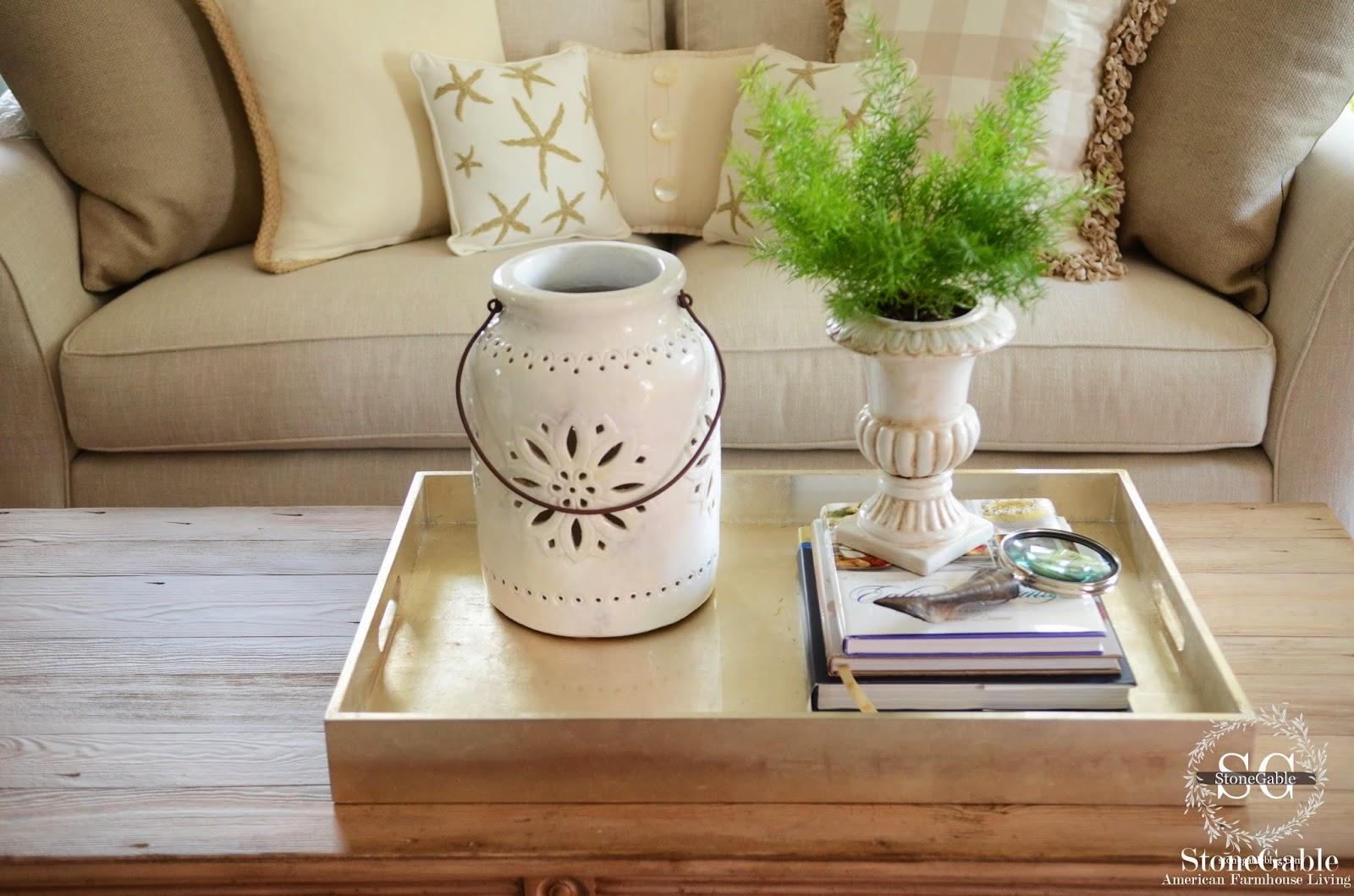 5 tips to style a coffee table like a pro stonegable the fern is tall the pottery is medium height the books are low and the sides of the tray are even lower this lets our eyes move around the tray and geotapseo Image collections