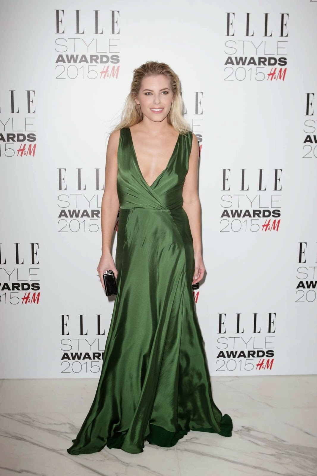 Mollie King in a low-cut Ralph Lauren dress at the 2015 Elle Style Awards in London