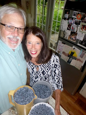 Wallace and Nancy Braud with a small portion of the 2015 Blueberry harvest at St Francis Cottage