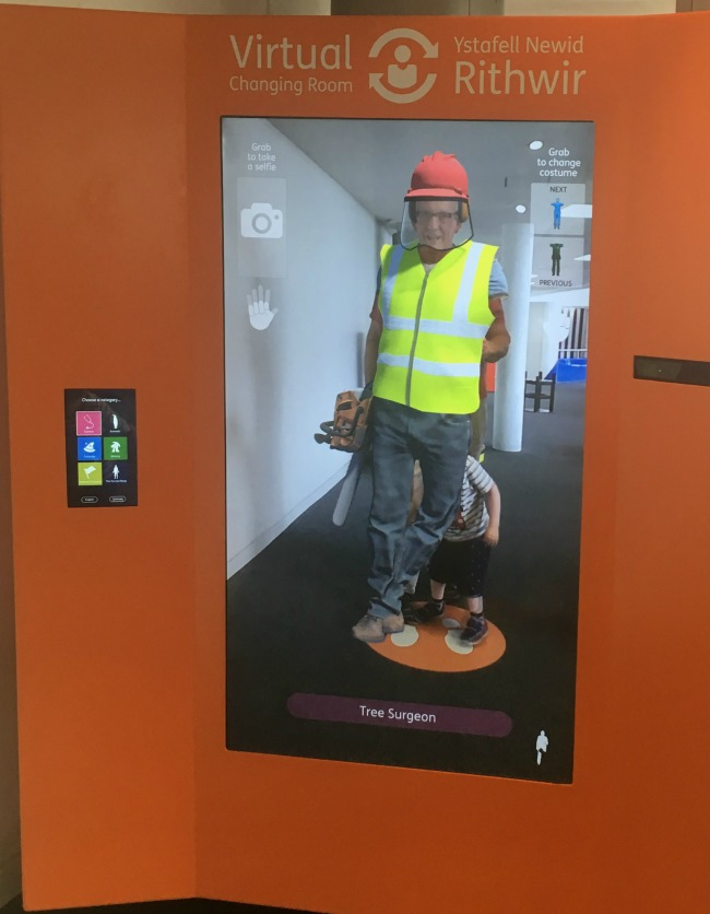 Techniquest-Virtual-Reality-changing-room-a-toddler-explores-an-image-of-a-tree-surgeon