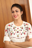 Lavanya Tripathi in Summer Style Spicy Short White Dress at her Interview  Exclusive 224.JPG