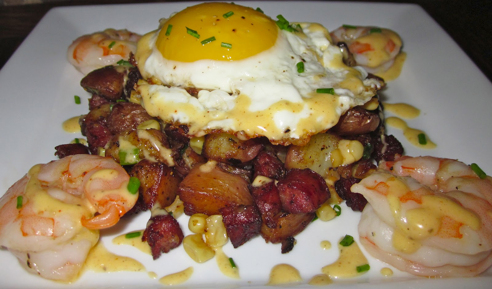 Haute Heirloom Low Country Boil Inspired Hash With Sausage Corn Potato Hash Roasted Shrimp A Fried Egg Old Bay Hollandaise