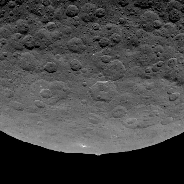 This image, taken by NASA's Dawn spacecraft on June 14, 2015, shows an intriguing mountain on dwarf planet Ceres protruding from a relatively smooth area. Credits: NASA/JPL-Caltech/UCLA/MPS/DLR/IDA