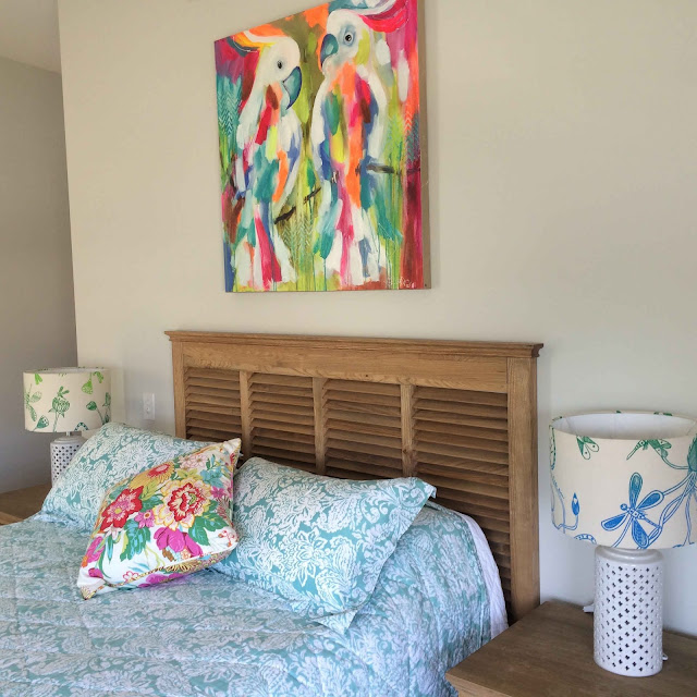 Handmade lampshades feauring dragon fly fabric by Injalak Arts in a contemporary bedroom