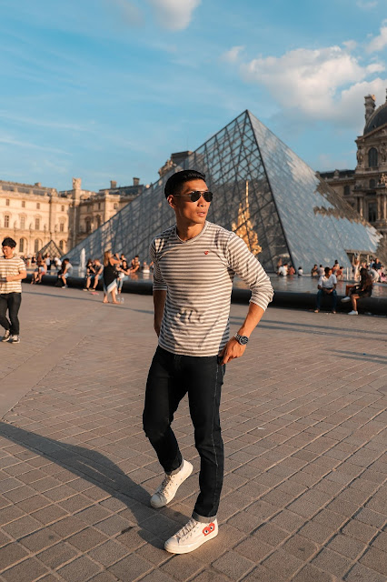 Leo Chan outside of the Louvre Museum in Paris