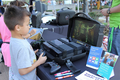 image of young attendee playing a video game