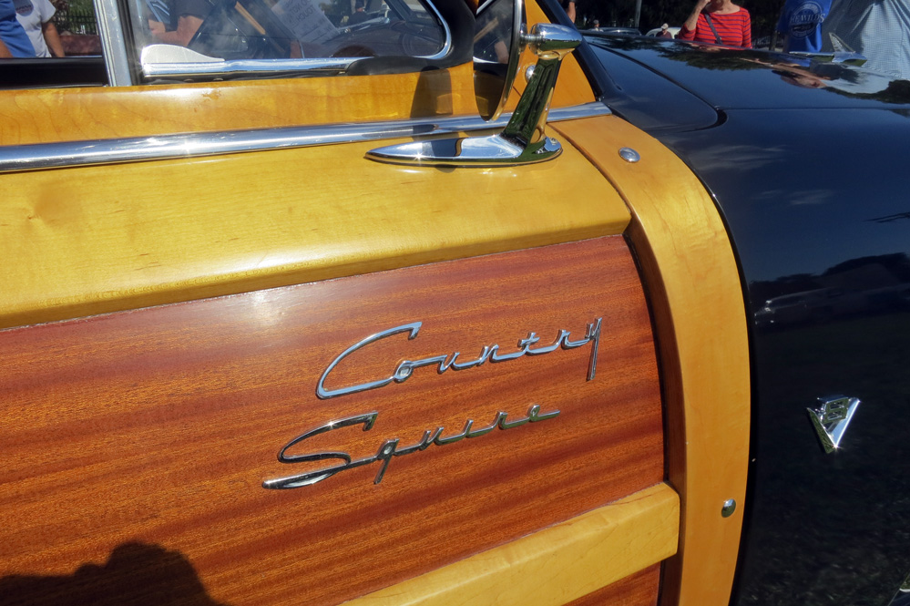 Country Squire name on woody station wagon.