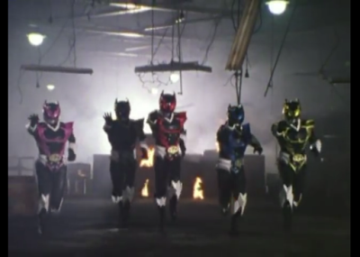 The Psycho Rangers, evil power rangers stand in a burning building