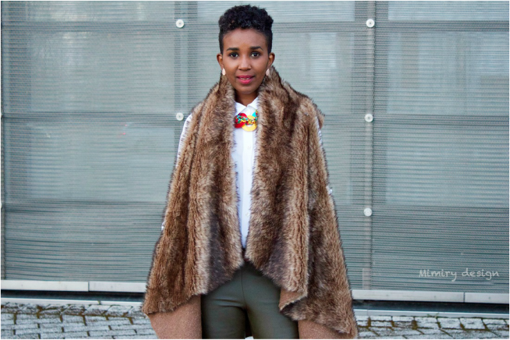 dark skinned woman wearing brown faux fur coat