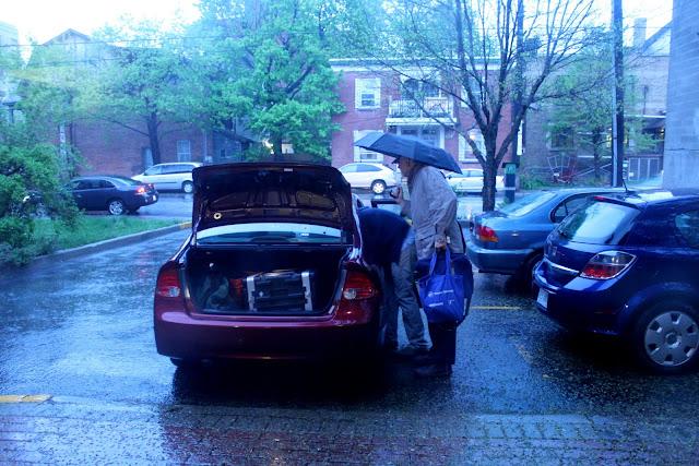 unloading equipment in pouring rain