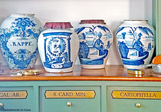 Blue and white jars a top the green cabinet