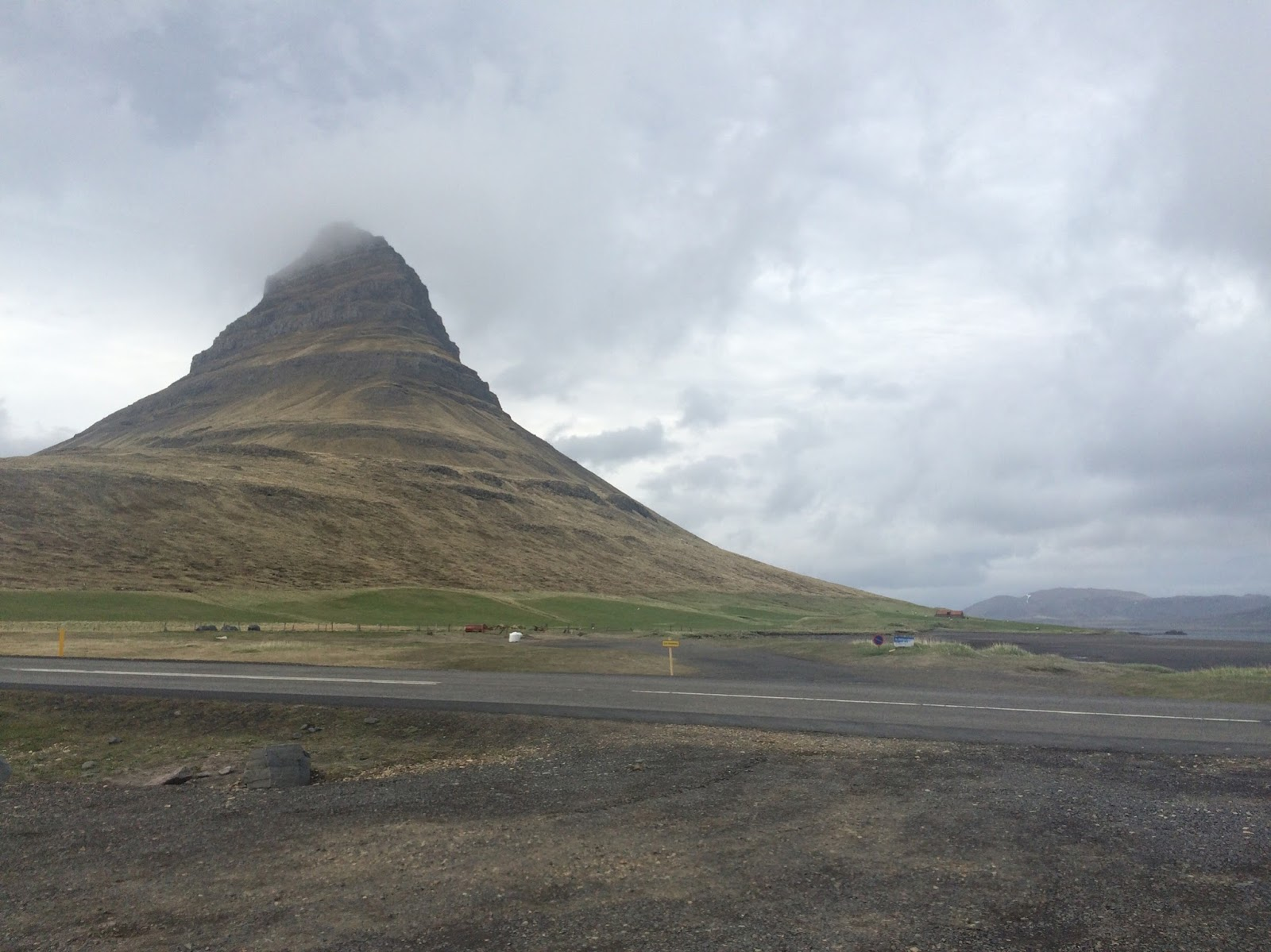 Driving along the Iceland fjords on a cloudy day