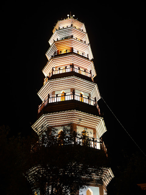 Fufeng Pagoda (阜峰文塔) with lights on at night in Zhongshan