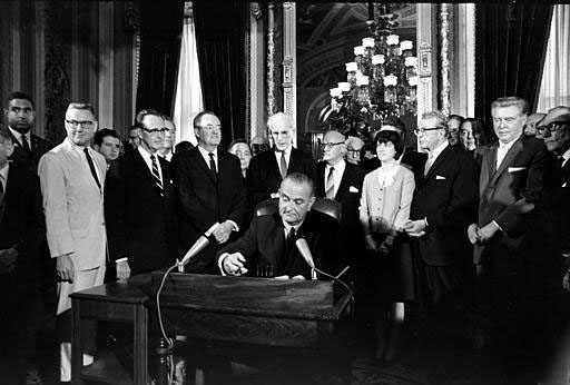 President Johnson signs the Civil Rights Act of 1968 into law on April 11, 1968.