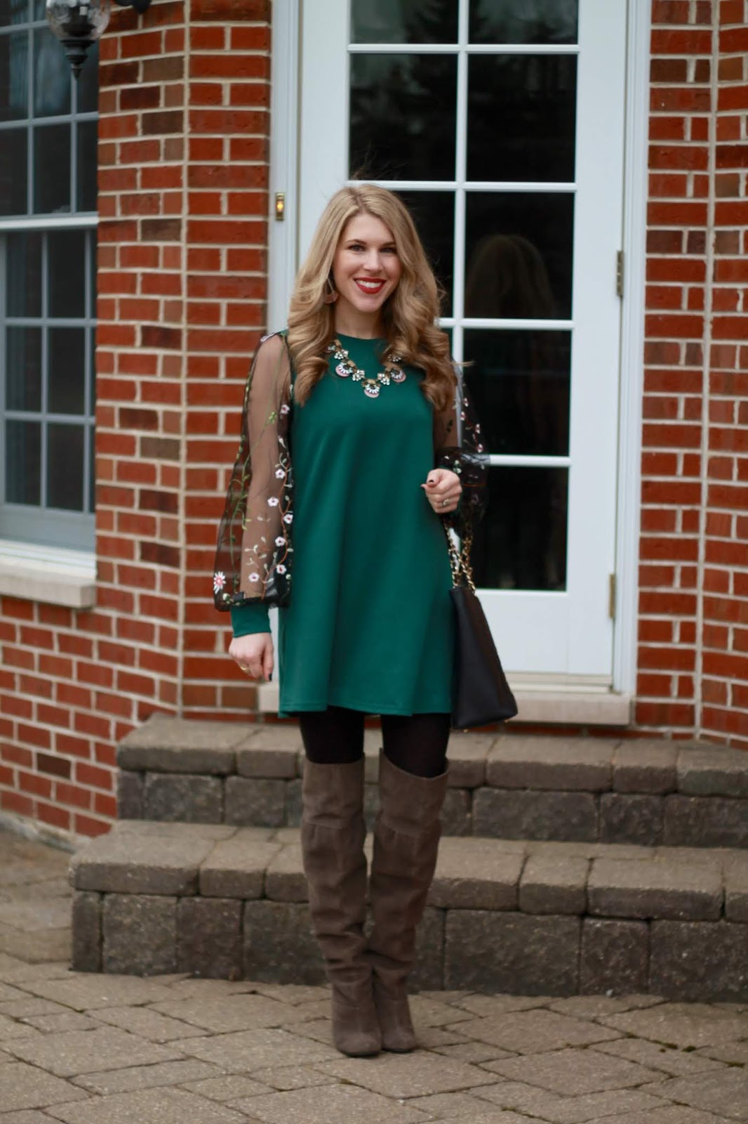 green dress with lace sleeves, grey heeled OTK boots, black leather quilted tote
