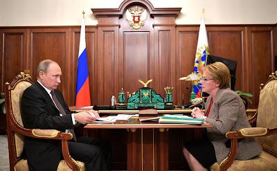 Vladimir Putinand Healthcare Minister Veronika Skvortsova.