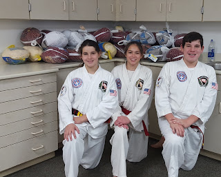 Kids martial artists doing community service