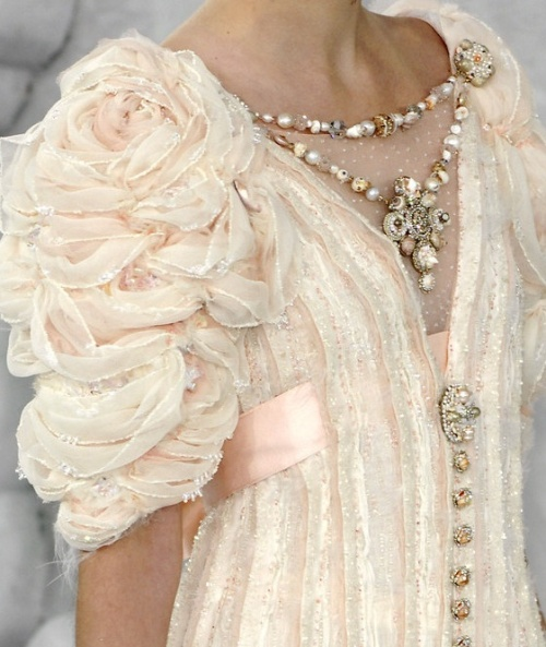 runway details: Chanel romantic light pink dress with bold jewellery