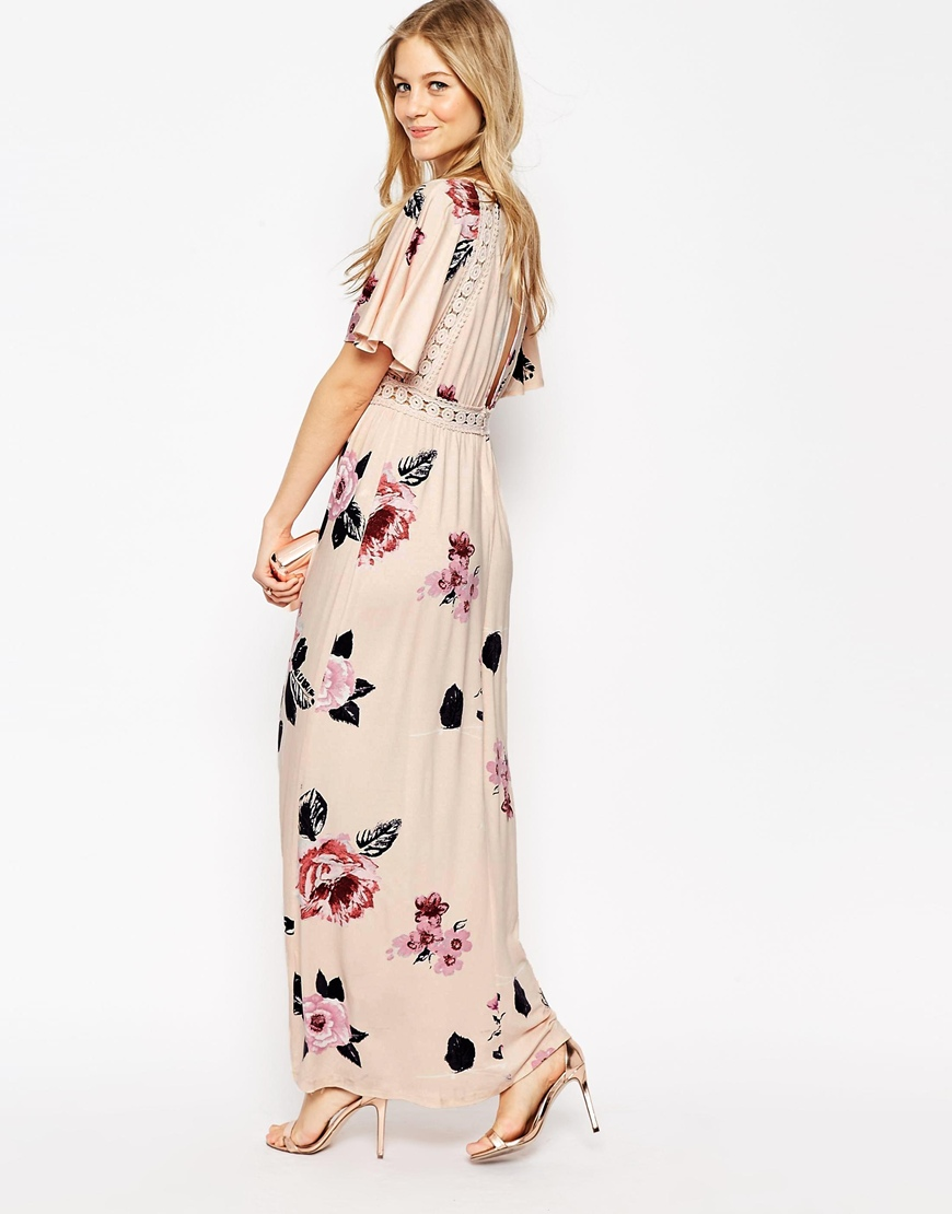 http://www.asos.com/ASOS/ASOS-Angel-Sleeve-Maxi-Dress-With-Lace-Inserts-In-Floral-Print/Prod/pgeproduct.aspx?iid=6048209&WT.ac=rec_viewed&CTAref=Recently+Viewed