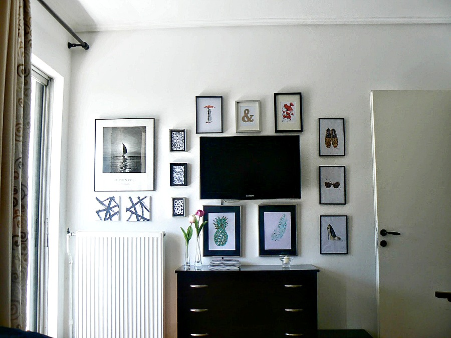 How to hide a mounted tv with a gallery wall