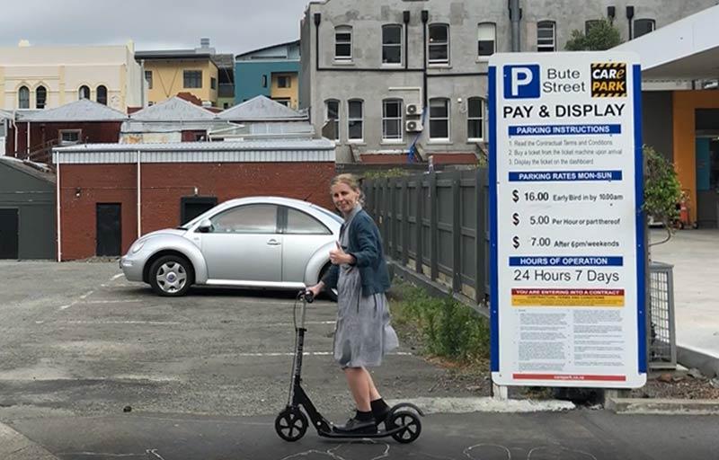 Hazel saving parking money on her Micro Scooter