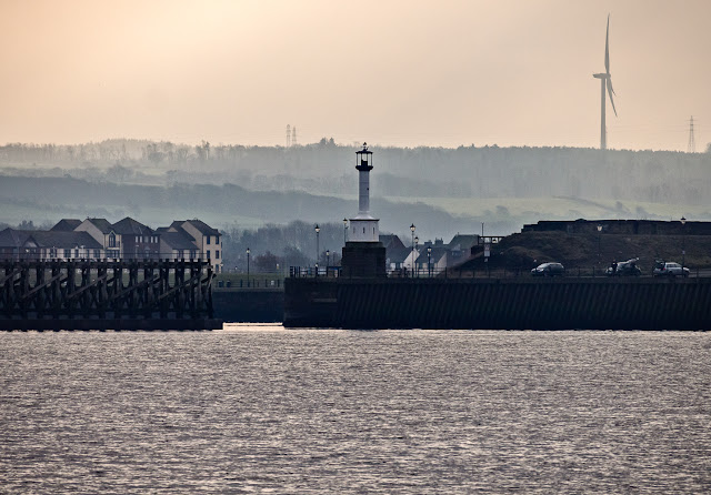 Photo of Maryport's old lighthouse and the entrance to the basin from the Solway Firth