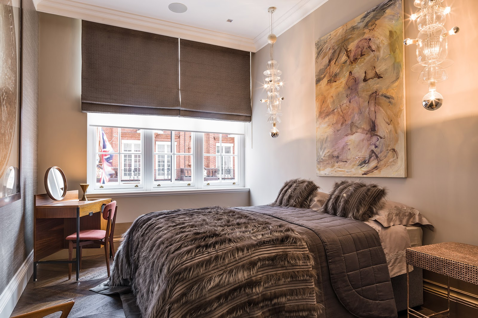 bedroom with wood decor and mid century modern influence inside of the luxurious London apartment