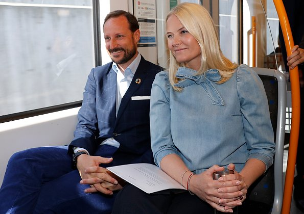 Crown Princess Mette-Marit wore ULLA JOHNSON Wes bow-embellished denim blouse. Crown Prince Haakon