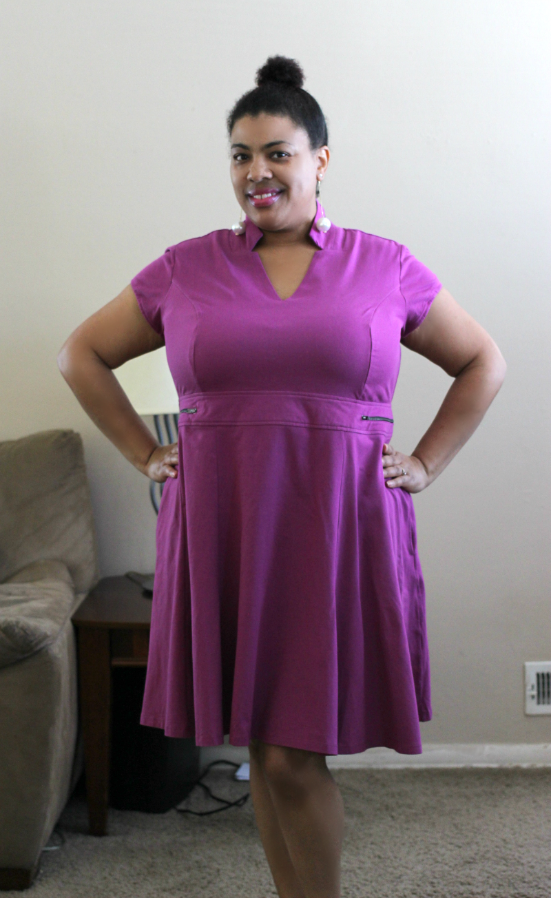 a black woman wearing a purple dress