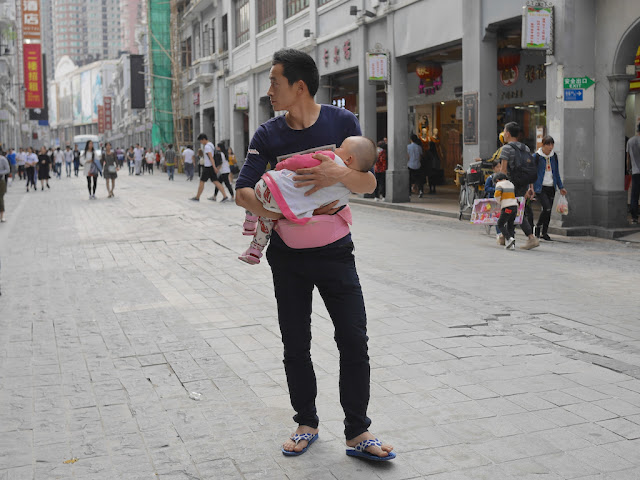 many carrying a baby