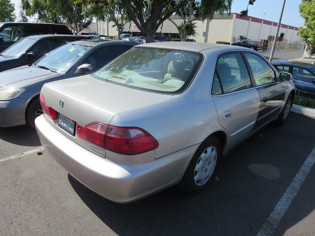 1999 Honda with faded & mismatched paint before repairs at Almost Everything Auto Body
