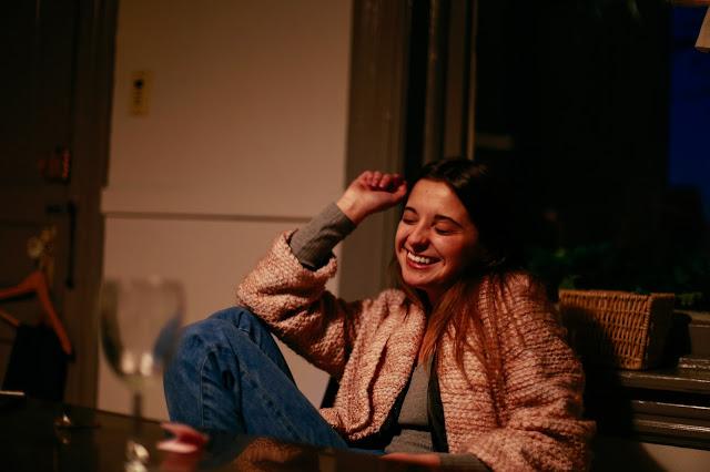 fashion blogger laughing
