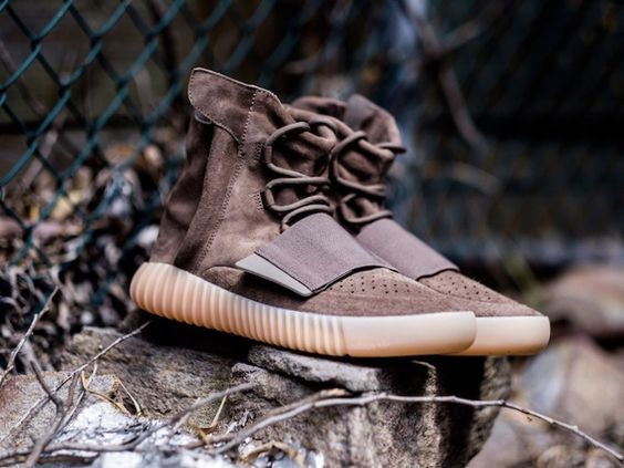 """fa153976c8185 The adidas Yeezy Boost 750 """"Chocolate"""" features a premium and deconstructed  nubuck upper done in light brown with an elastic midfoot strap"""