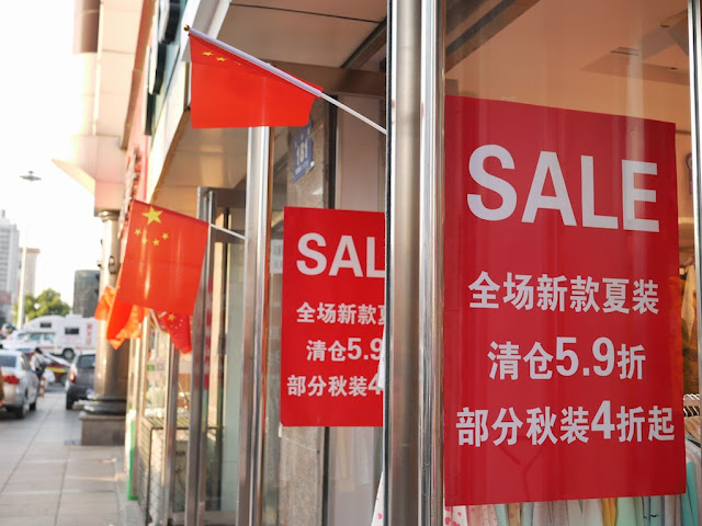 "National Day ""sale"" signs in Mudanjiang, China"