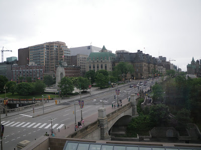 This photo is of the Plaza Bridge, which spans the Rideau Canal to connect Wellington and Rideau Streets, looking east up Wellington Street with Confederation Square in the foreground and Parliament Hill on the right. It was not taken in the 1800s, but in 2012 when I visited the Chateau Laurier during Doors Open Ottawa
