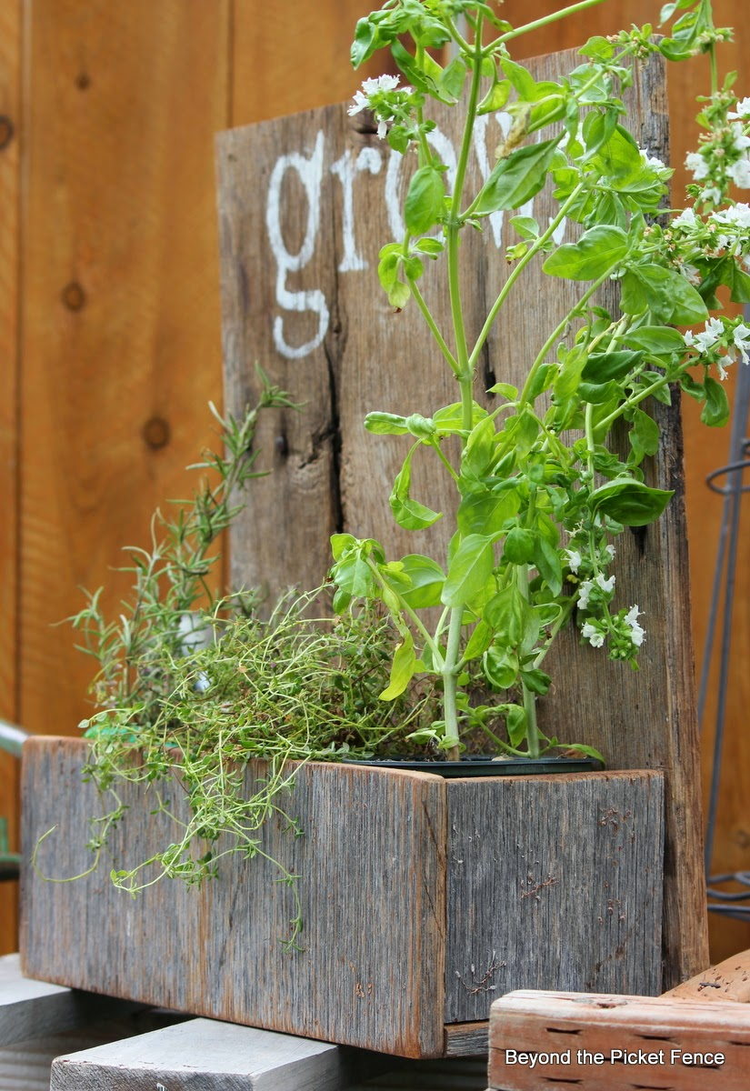 grow planter made with reclaimed barn wood http://bec4-beyondthepicketfence.blogspot.com/2014/05/grow-rustic-wood-planter.html