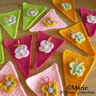 Crocheted button butterflies on party banner bunting