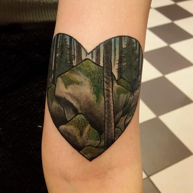 amazing, beautiful heart tattoo on arm