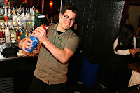Bartender shaking a drink in a nightclub