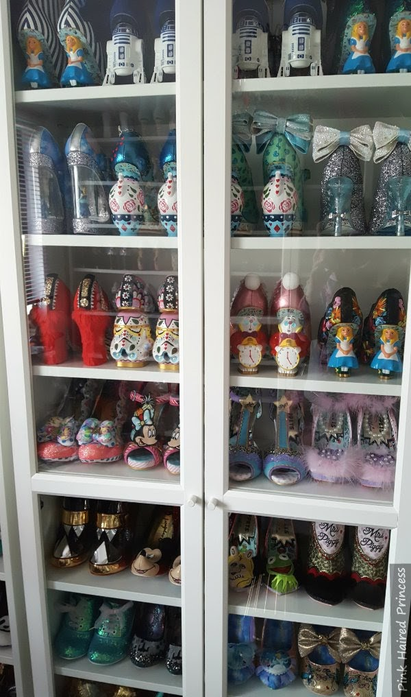 shoe cabinet in shoe room with Irregular Choice Disney shoes behind glass doors