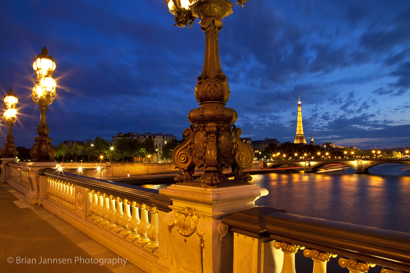 C'est Magnifique! The visual romance of Paris, France, sparkles in the twilight. Photo: © Brian Jannsen Photography. Unauthorized use is prohibited.