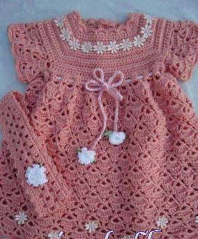 Pink crocheted dress baby patterns very beautiful