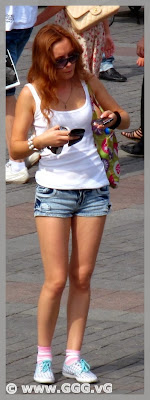 Tanned girl in denim mini shorts on the street