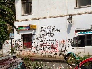 Graffiti and writings on the wall of a residential building.