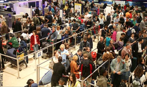 "Image: Roger Taylor. Daily Telegraph: ""Airport queues longer than flights"""