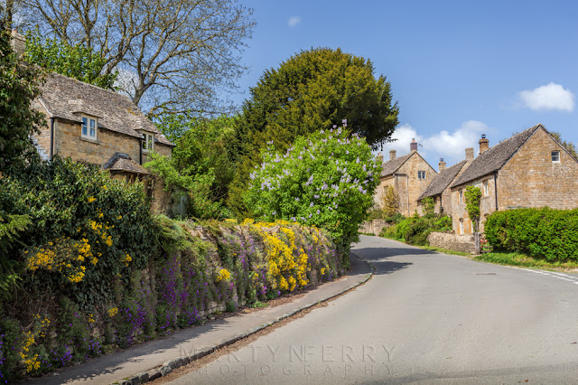 Cotswold village of Guiting Power on a sunny day with beautiful flowers
