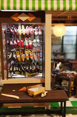 Front window of a miniature Hong Kong shoe shop from the 1960s.