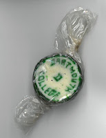 image of a round hard candy with Dartmouth College and a D worked into the candy in greey.