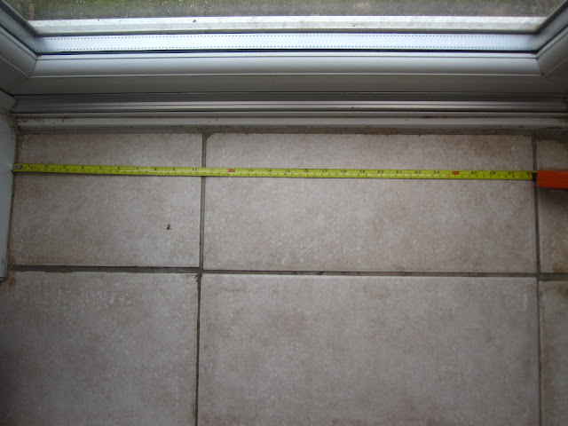 Tape measure being used to measure a door